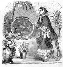 woman and child looking at a large bowl aquarium